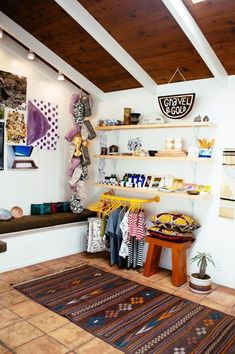 my number 2. I like the pops of yellow the vignettes of shelving and the small selection of clothing
