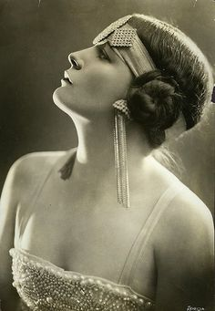 A decorated hair beadeau. Are those tassels earrings?