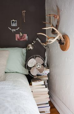 Stacked books make me happy. I like the idea of using stacks of books for a side table or coffee table or picture stand. All sorts of things.