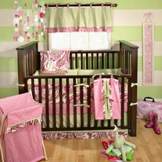 Traditional Crib Bedding By My Baby Sam   It's the colorful paisley print in lime and the bright pinks. Like except not a fan of the pink polka dots or the crazy striped wall.