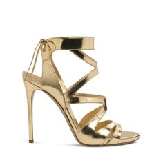 EVENING Casadei casadeiwolrd Wrap-around sandal in gold laminted mirrored-leather and adjustable leather ties. Stiletto leather covered heel. 3.9 inches with a 0.4 inches concealed plateau. Laminated mirrored-leather Made in Italy