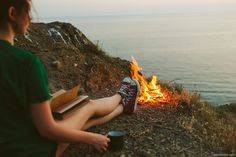 Girl near fire on the seaside