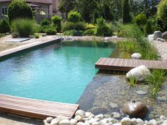 Check out tons of beautiful pond swimming pool designs to enhance the beauty of your outdoor living space. Pick the best ide and build your own pool now!