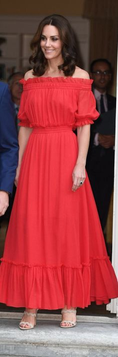 Who made  Kate Middleton's red off the shoulder dress and tan sandals?