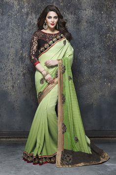 Buy Green Net Designer Saree Online in low price at Variation. Huge collection of Designer Sarees for Wedding. #designer #designersarees #sarees #onlineshopping #latest #lowprice #variation. To see more - https://www.variationfashion.com/collections/designer-sarees