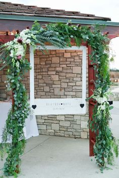 Wedding reception ideas, unique photo booth, wooden polaroid frame, leafy garland, photo station // Kaysha Weiner Photographer