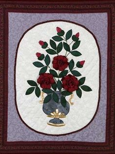 "Vase of Roses ..Make a quilt featuring 3-D roses! It's easy with this free beginner quilting pattern. Stitch this wall quilt and create a beautiful piece of art that will look lovely in your home. This would make a thoughtful gift for a friend that loves sweet-smelling roses.Quilt Size: 25"" x 31"" Skill Level: Beginner"