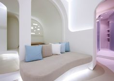 "KLab decks out Santorini hotel in smooth curves to mimic the ""cave-like"" houses on the Greek island"