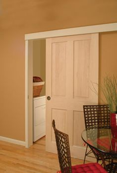 a pocket door without the pocket - to replace bi-fold doors in entry to dining room?
