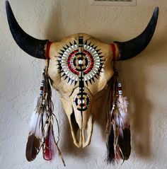 Original artwork, hand painted buffalo skull with peyote beadwork. By Ken Collier