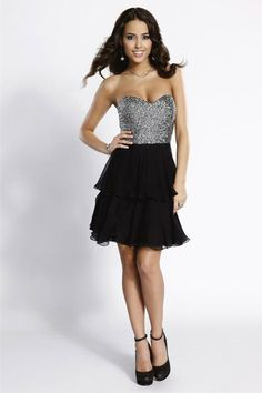 Super Star Debut you will have when you wear this strapless short dress with hand sewn bead work embellishing the fitted bodice and a fun and flirty double tiered dancing skirt! $178.00