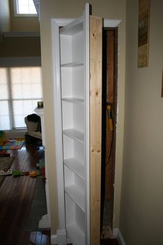 Hidden Bookshelf Door to provide access behind a wall. Link to Reddit Thread: http://www.reddit.com/r/DIY/comments/1f1pjo/needed_access_to_a_space_behind_a_wall_so_i_built/