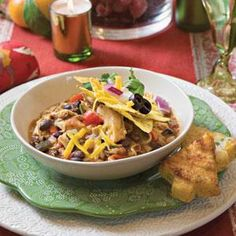 Smoky Chicken Chili - Pick up smoked chicken from your favorite barbecue restaurant to make this dish, or use a barbecue-flavored rotisserie chicken from your local supermarket.