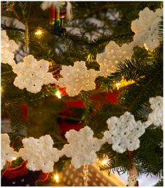 White Snowflake Garland.... I'm make these to hang like falling snow over the tables