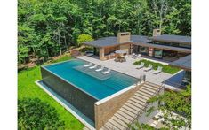 A Serene Amagansett Modern Returns to Market for a Discount - DailyDeeds - October 2018 backyard modern A Serene Amagansett Modern Returns to Market for a Discount - Cottages & Gardens Sloped Backyard, Small Backyard Pools, Backyard Pool Designs, Swimming Pools Backyard, Swimming Pool Designs, Pool Landscaping, Outdoor Pool, Infinity Pool Backyard, Backyard Patio