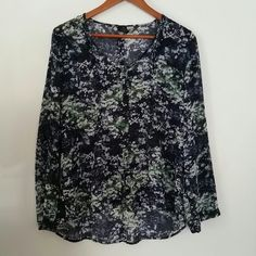 NWOT Calvin Klein abstract pattern top Pleated detail front and back center. 100% polyester exterior.  Cotton blend interior. Five buttons down front. Spare button included. Rounded v-neckline. Loose fitting. Sleeves can be worn at full length or buttoned to 3/4. Calvin Klein Tops Blouses