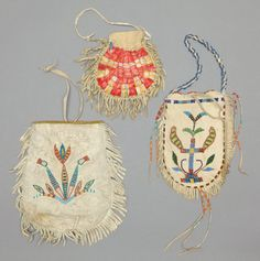 THREE SIOUX BEADED/QUILLED HIDE POUCHES. c. 1890... (Total: 3Items)