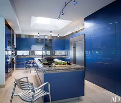 Architect Robert M. Swedroe renovated his Biscaya Island, Florida, home with the help of designer Toby Zack. The pair installed blue high-gloss metallic lacquered cabinets from Snaidero and a marble-top island with a six-burner cooktop.