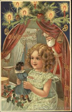 Little girl holding a doll Santa Claus