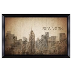 Framed giclee print with a collage-style New York City motif.   Product: Framed giclee printConstruction Material: