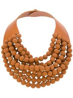 Brown calf leather necklace from Rosanna Fani featuring a multi-strap textured beads design to the front, a thick leather neck strap and a push bead fastening.