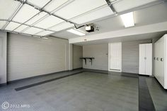 Garage. Painted Floor. Peg walls. Storage.