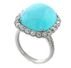 16.76 paraiba tourmaline cabochon in ring by Leon Mege - AGTA 2012 winner