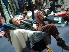 Erin homeless man- beerbottle and old trolley and odd shoes