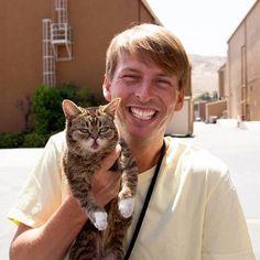 Jack McBrayer with a cat.