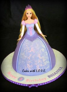 Rapunzel doll - Rapunzel Barbie doll :) My first doll cake!!!!  Customers are visiting from NC and ordered this from me since they were going to Disney world, they even mailed the doll ahead of time, how cool is that ! All of the details are done in fondant.  They Loved her!