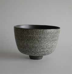 Rupert Spira  - simple bowl with black slip, incised (usually) with words.  Sometimes he sgraffitos and sometimes he presses negatives into clay to give relief on the object.
