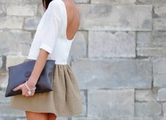 a low back shirt with a beige skirt