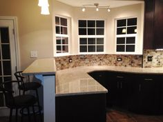 Kitchen Remodel- Glass Tile Backsplash, Silestone Countertop, Pendant Lighting, Directional Lights, Bar Area, Bar Stools