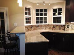 Kitchen Remodel- Glass Tile Backsplash, Silestone Countertop, Pendant Lighting, Directional Lights, Bar Area, Bar Stools