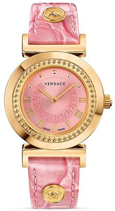 Versace Vanity Watch, 35mm - The Versace Vanity features an ion-plated rose gold case with a subtle studded bezel surrounding a bright pink sunray dial detailed with a classic Greek key. A pink crocodile embossed calf leather strap with signature Medusa head accents adds a fun modern touch to classic luxury. Wow I would so love this!