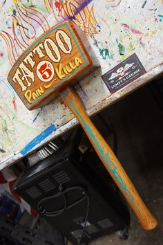 """Check out my latest addition to my #etsy shop: Hand painted Garage Art """"5cent Tattoo pain killa"""" hand made wooden mallet signage"""