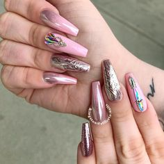 Rose Gold Metallic Designs For Coffin Nail Shape #chromenails #pinknails #rhinestonesnails #metallicnails ❤️ You have to see these coffin nail designs for inspiration if you are looking for a fresh design for them. Check out our trendy ideas for coffin nails and get inspired. ❤️ See more: https://naildesignsjournal.com/coffin-nail-designs/ #naildesignsjournal #nails #nailart #naildesigns #coffinnails #longcoffinnails #longacrylicnails #acrylicnails #coffinnailsshape #longnails