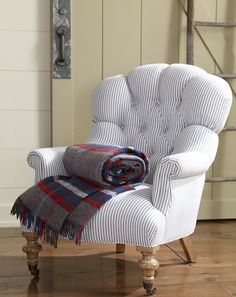 Ticking stripes have a light, breezy feel; when the evening breeze gets cooler, soft wool throws are always in season.