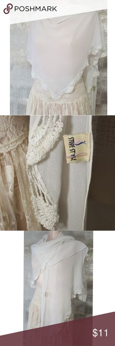 White sheer scarf / wrap crochet details White sheer scarf or can be worn as a wrap has crochet details along the edging no visible signs of wear or damage  Pre owned condition *******All items are in pre owned condition, Nothing, unless noted , is brand new **** please ask questions For sale in my posh closet  LINK IN MY BIO Accessories Scarves & Wraps