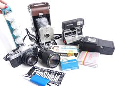 Vintage camera score! Polaroid Land Camera Model 95B, Canon AE-1, Polaroid 600 Land Camera, and lots of accessories! All to be listed in our Etsy shop soon.