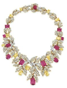"""A DIAMOND, RUBELLITE TOURMALINE AND YELLOW SAPPHIRE NECKLACE, BY DAVID WEBB - Of foliate motif, designed as a graduated cluster of circular-cut diamond leaves, set with variously-shaped rubellite tourmalines and yellow sapphires, mounted in 18k gold and platinum, signed """"Webb""""    c.1965"""