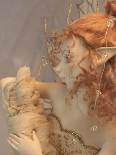 Absolutely beautiful, tender, full of love... What a wonderful sculpture made by talented artist, Hannie Sarris!