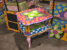 Wow!! Great site for funky painted furniture!