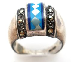 "Vintage Mosaic Jewelry Rings - This is a wide cigar band ring with inlay gemstones of lapis, turquoise, and mother of pearl accented with marcasites. This ring measures .5"" wide and weighs 8 grams."