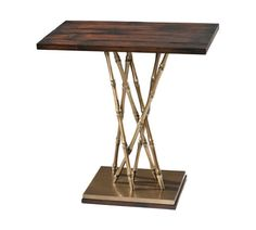 "A brass and parquet finish crushed bamboo accent table, the rectangular top above a ""gathered"" bamboo stem base mounted on a brass and mahogany platform base. Next to wing chair in the library room"