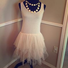 Cream tan color Tutu Ruffle muscle shirt tank Fits small to medium and stretchy. No flaws. Goes slightly past knee A' reve Dresses Midi