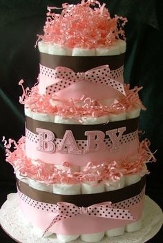 diaper cake. made one similar to this for Fallon's shower...I think Jackie posted a pic on my FB page of the one we made...