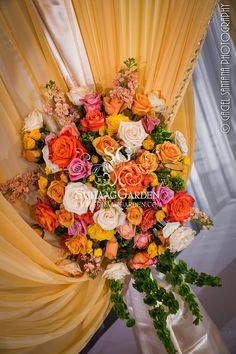 Suhaag Garden, Florida Indian Wedding Decorators, The Vinoy Renaissance St. Petersburg Resort & Golf Club, Flower Bouquet, Mandap Flowers,  Coral Peach Yellow Roses, Ivory Chiffon Fabric, Fabric Mandap