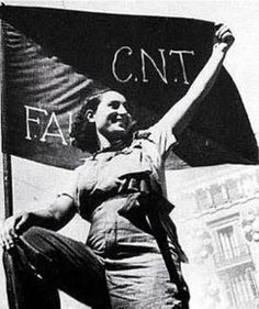 "Uncredited Photographer Woman Supporter of the Anarchist CNT-FAI During the Spanish Civil War c.1936 ""Young men, prepare for combat! Women…fight alongside your men in order to defend the lives and..."
