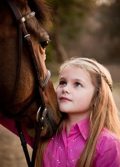 I love how she's looking at her horse, so sweet<3